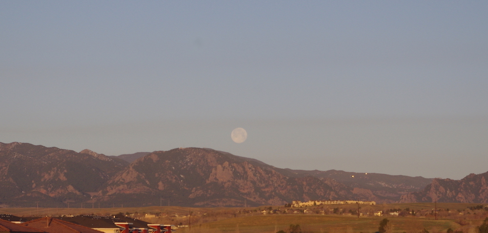 Pink Moon setting over the Rocky Mountains
