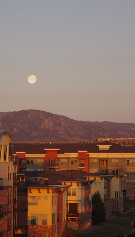 Pink Moon setting over Broomfield, CO apartments