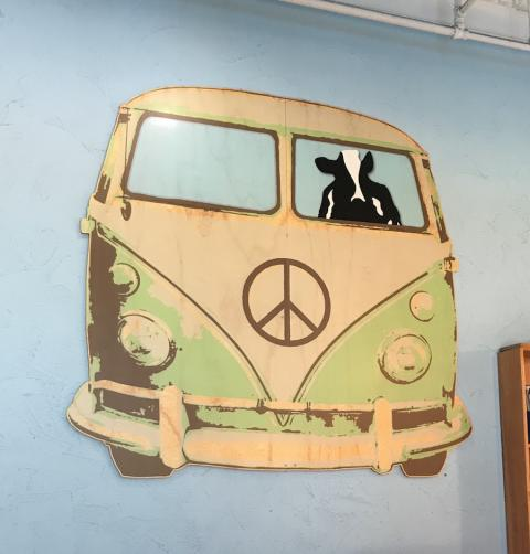 A cow driving an old Volkswagen van