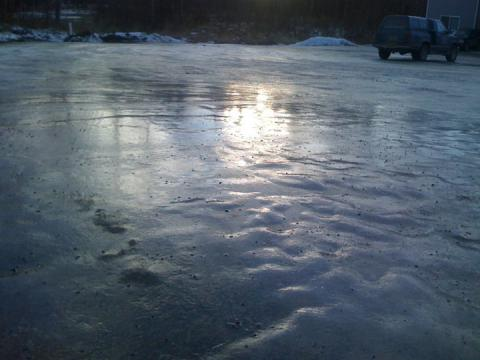 A thick layer of ice in the parking lot, Wasilla, Alaska